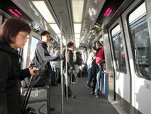 People ride the AirBART automated people mover at SFO royalty free stock image