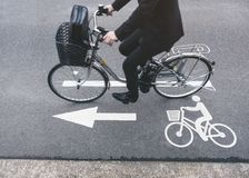 People ride bicycle on Road Bike lane Signage stock photo
