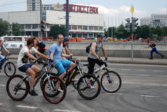 People ride bicycles in Moscow. MOSCOW, RUSSIA - JUNE 16: Many people ride bicycles. Cycle race in Moscow city center on June 16, 2013 in Moscow Stock Images