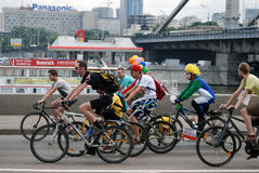 People ride bicycles in Moscow. There are clowns among them. Royalty Free Stock Photos