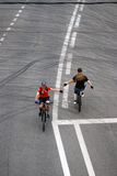 People ride bicycles in Moscow and try to shake hands royalty free stock photo