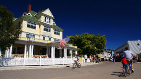 People ride bicycles to see village of Mackinac Island Stock Image