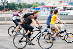 People ride bikes Stock Photography