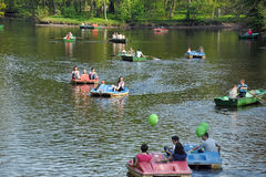 People ride on boats  in the city park summer day Royalty Free Stock Photography