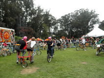 People ride crazy bicycles in circles in celebration of bicyclin Royalty Free Stock Photography