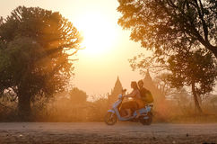 People ride e-bike in Bagan, Myanmar Stock Photos