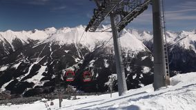 People ride gondolas of cable car in Bad Gastein. stock video