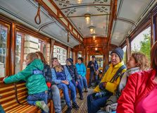 People ride historic tram in Prague, Czechia royalty free stock photography