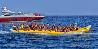 People ride on an inflatable boat into the sea Royalty Free Stock Image