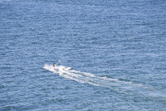 People ride jetski on blue sea. People ride jetski with high speed on blue sea at Hua HIn, Thailand with copy space Royalty Free Stock Images