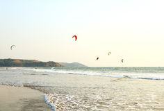 People ride on Kitesurf at sea Royalty Free Stock Image