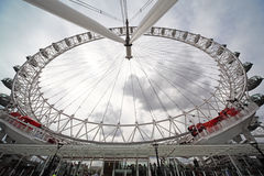 People ride the London Eye at the summer. Warm day in London royalty free stock photography