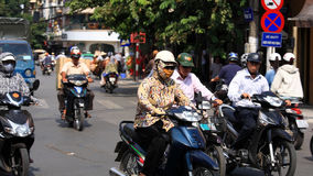 People ride motorbikes on busy road in Hanoi Royalty Free Stock Photo