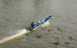 People ride motorboat on river in Tra Vinh, Vietnam Royalty Free Stock Photography