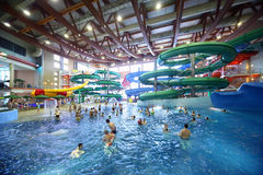 People Ride On Chutes And Swim In Pool Royalty Free Stock Photography