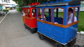 People ride in park attractions in train.  stock footage
