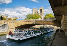 People ride on a pleasure boat on the river Seine Royalty Free Stock Image