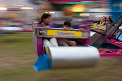 People Ride The Scrambler At County Fair Stock Images