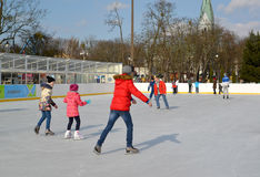 People ride a skating rink. Central park of rest, Kaliningrad Stock Images