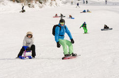 People ride on the snow-covered slopes of the ski resort Dombai Royalty Free Stock Image