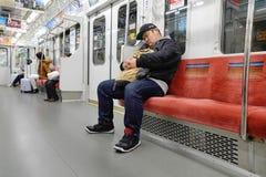 People ride Tokyo metro transit system in Tokyo Royalty Free Stock Images