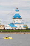 People ride on the yellow katamarene in the Gulf city of Cheboksary, Chuvash Republic. 08/05/2016. Against the backdrop of the Tem Royalty Free Stock Photo
