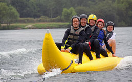 People riding on a banana boat Royalty Free Stock Photos