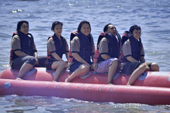 People riding on a banana boat in bali beach Royalty Free Stock Photo