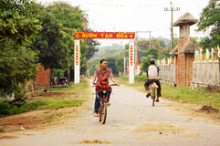 People riding bicycle at countryside Stock Images