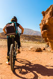 People riding bicycles along the canyon Stock Photo