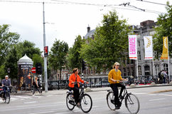 People riding bicycles in Amsterdam Royalty Free Stock Image