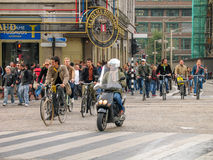 People riding bicycles on central street in historical part of the city Stock Photos