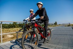 People riding bicycles. Healthy lifestyle - people riding bicycles Royalty Free Stock Image