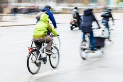 Bicycle riders motion blur royalty free stock images