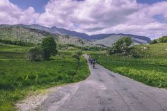 People riding bicycles on the scenic roads of Black Valley in county Kerry, Ireland royalty free stock images
