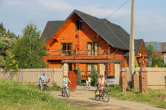 People riding on  bicycles in Schodnica, Ukraine Stock Image