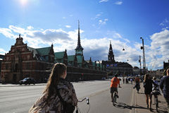 People riding bicycles on a street in Slotsholmen, view on a fam Royalty Free Stock Image