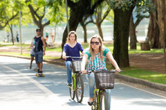 People riding bike in Ibirapuera Park in Sao Paulo, Brazil Royalty Free Stock Images