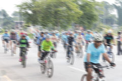 People riding bikes with motion blur. Royalty Free Stock Image