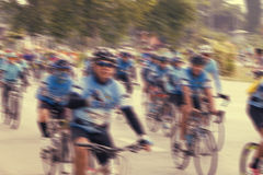 People riding bikes with motion blur. Stock Photo