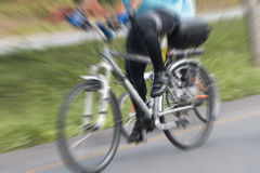 People riding bikes with motion blur. Royalty Free Stock Photos