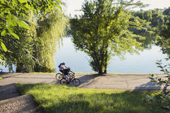 People riding bycicles in the park Stock Photography