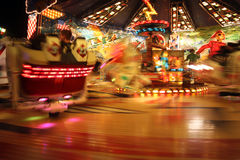 People Riding Carnival Ride At Night Royalty Free Stock Images