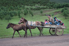 People riding in carriage Royalty Free Stock Images