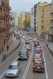 People are riding in cars on the road in Warsaw, Poland Stock Image