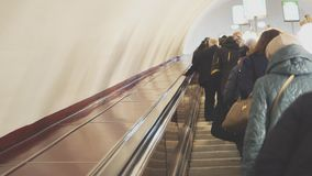 People riding the escalator. People riding the escalator in metro station stock video footage