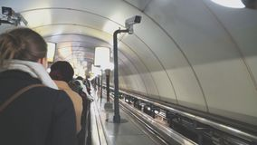 People riding the escalator. People riding the escalator in metro station stock video