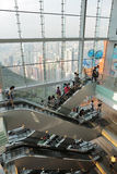People riding on escalators in a busy peak mall in Hong Kong Stock Photos