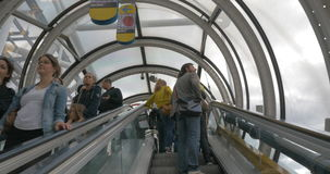 People riding escalators in glass tube. PARIS, FRANCE - SEPTEMBER 06, 2015: People riding up and down escalators in the glass tube of Centre Pompidou stock footage