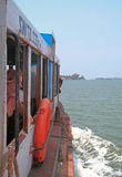 People are riding in ferry by sea Stock Image